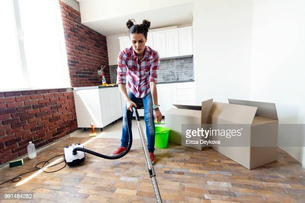 Woman cleaning her new home