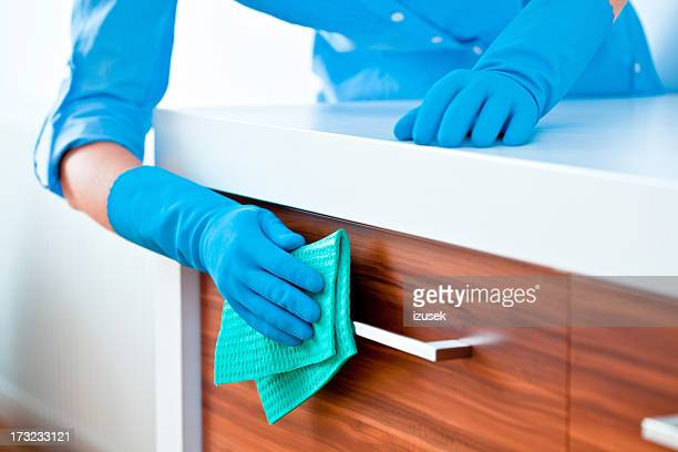 Woman Cleaning Kitchen Cabinets
