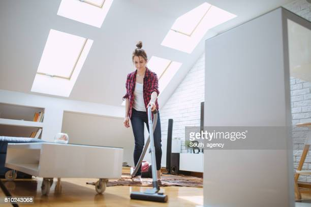Woman cleaning living room