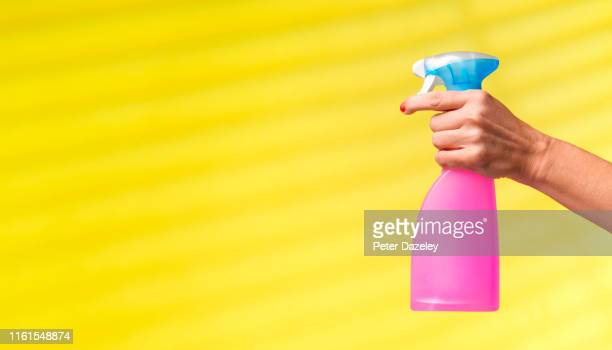 woman cleaning - cleaning agent stock pictures, royalty-free photos & images