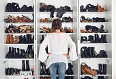 Woman cleaning shoes closet