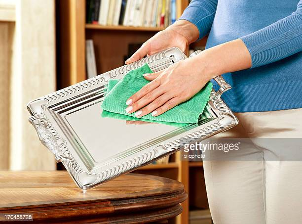 woman cleaning silverware - silverware stock pictures, royalty-free photos & images