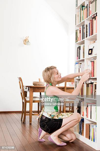 Woman cleaning up a room