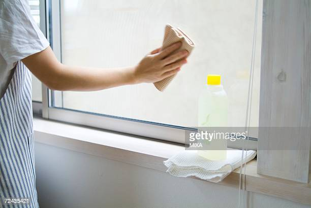 A woman cleaning window