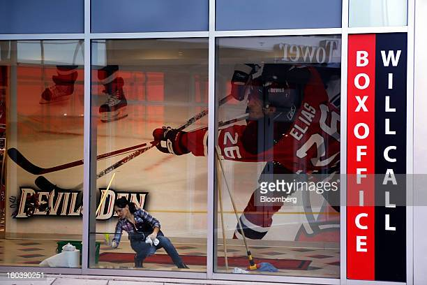 Woman cleans a window at the Prudential Center, home to the National Hockey League's New Jersey Devils, in Newark, New Jersey, U.S., on Tuesday, Jan....
