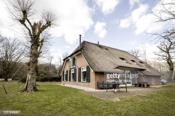 Woman cleans and arranges a holiday home owned by Staatsbosbeheer in Apeldoorn on March 26, 2021. - Dutch nationals are booking more holidays within...