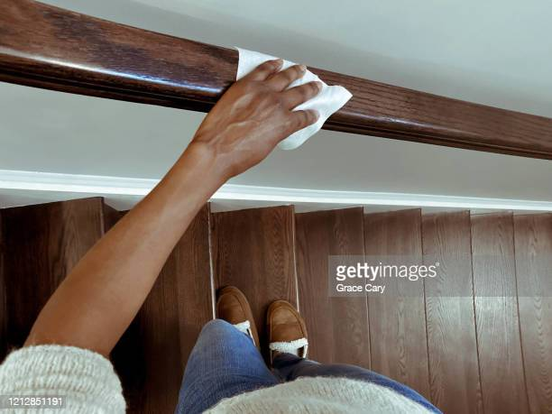 woman cleans handrail using disinfectant wipe - chores stock pictures, royalty-free photos & images