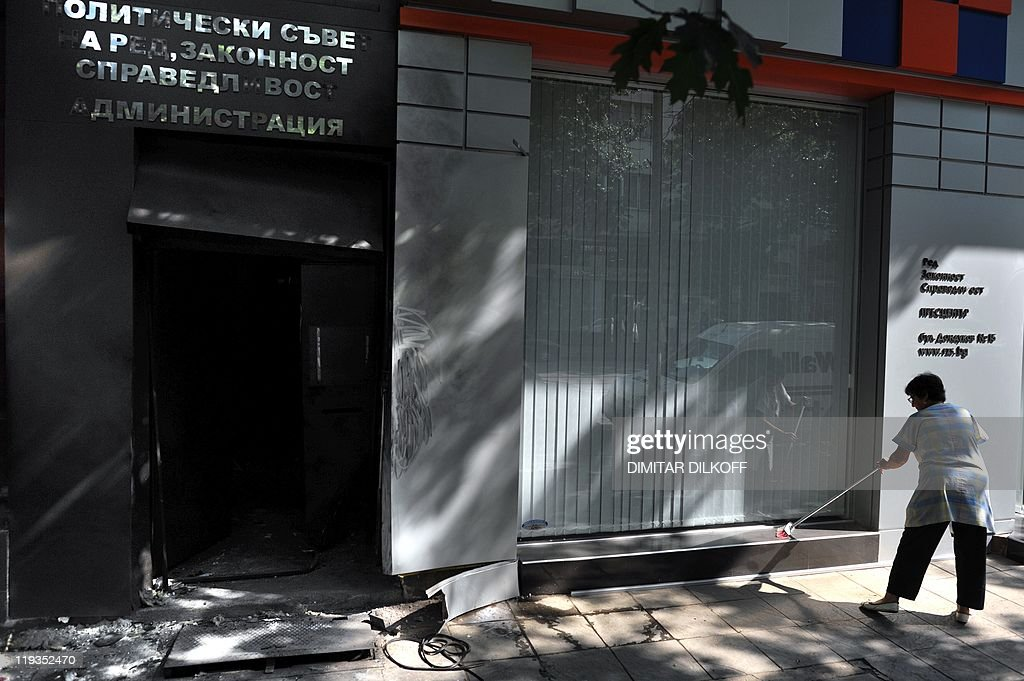 A woman cleans near the entrance of the : News Photo