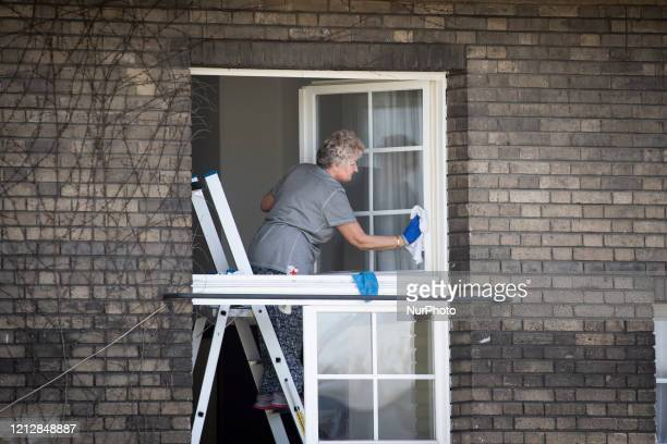 A woman cleans windows in a monastery in Warsaw Poland on April 20 2020