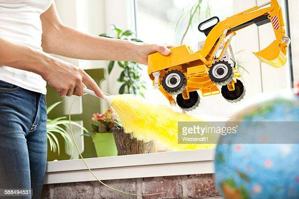Woman cleansing windowsill in childrens room