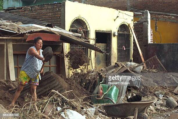 A woman clearing mud from the houses beside the Choluteca river
