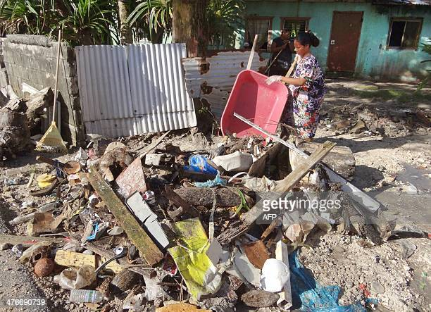 A woman clears the debris at Majuro Atoll in the Marshall Islands on March 3 after a king tide coupled with storm surges causing widespread flooding...