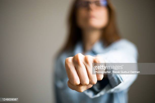 a woman clenching fist - black lives matter london stock pictures, royalty-free photos & images
