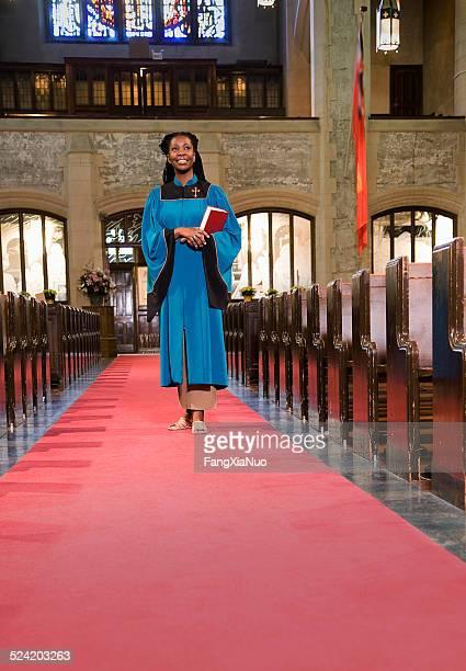 Woman Clergy Member Walking Down Church Aisle