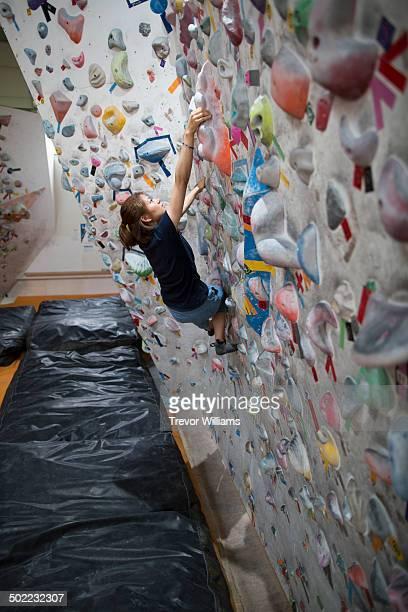 A woman climbing at a rock climbing gym