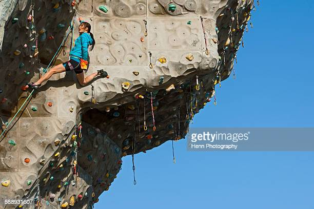 Woman climbing on artificial climbing wall in Seoul
