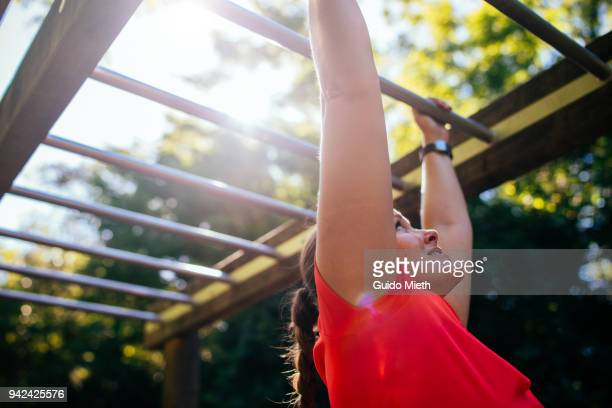 Woman climbing.