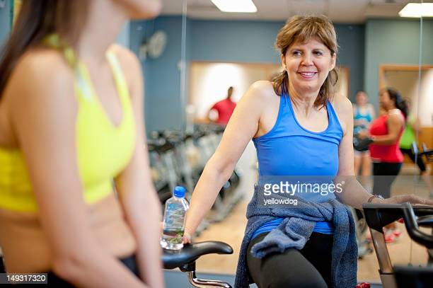 Woman climbing spin machine in gym