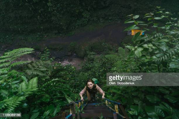 Woman climbing stairs in the jungles
