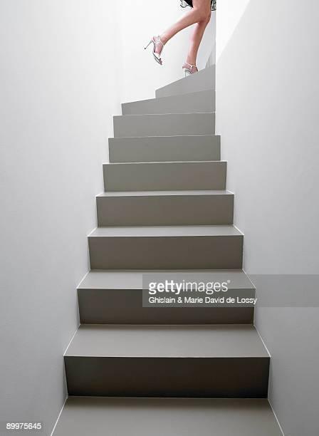 woman climbing the stairs - unterer teil stock-fotos und bilder