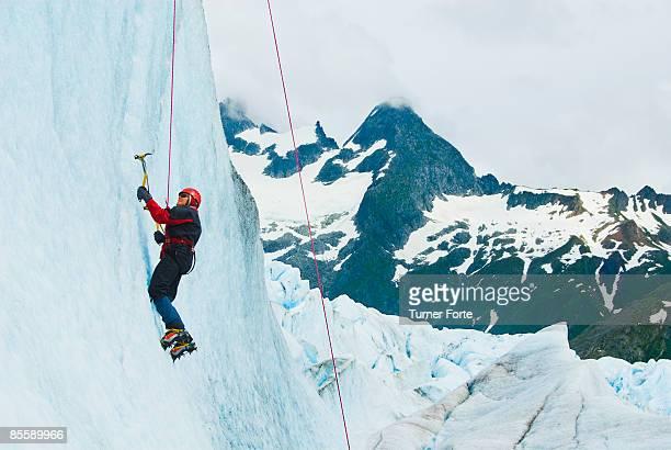 Woman climbs glacial cliff