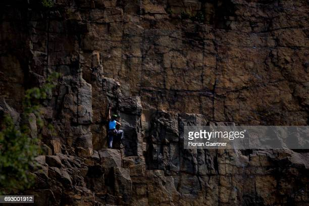 A woman climbs on the wall of a stone quarry on June 05 2017 in Koenigshain Germany