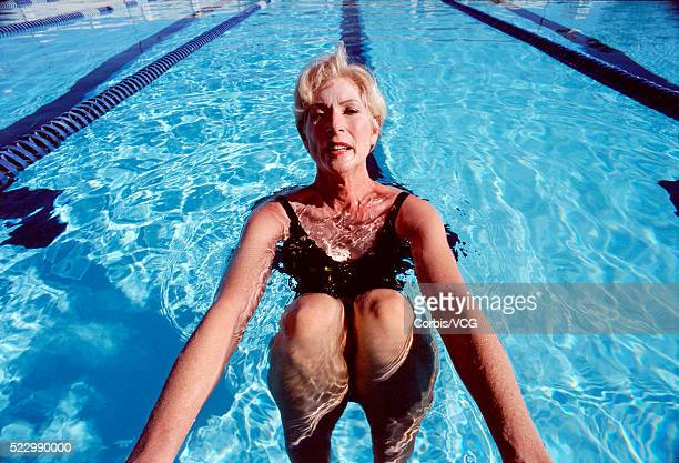 Woman Clinging to Side of Pool