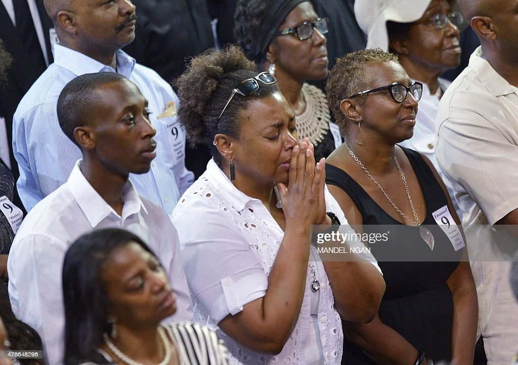 A woman closes her eyes while attending the funeral of Rev. and South Carolina State Sen. Clementa Pinckney, at the College of Charleston TD Arena, in Charleston, South Carolina on June 26, 2015.