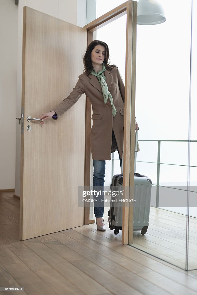 Woman closing the door of a house  Stock Photo  sc 1 st  Getty Images & Woman Closing The Door Of A House Stock Photo | Getty Images