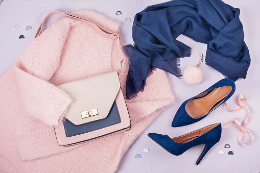 Woman clothing and accessories in pastel colors. 1071832408