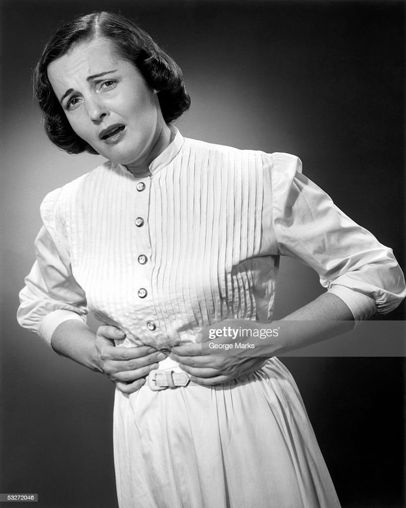 Woman clutching diaphragm in pain : Stock Photo