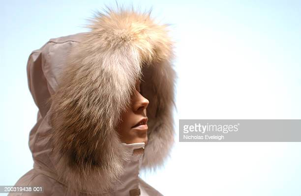 Woman coat with fur trimmed hood, side view, close-up