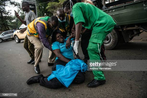 A woman collapses in shock after being rescued from the Dusit Hotel on January 15 2018 in Nairobi Kenya A current security operation is underway...