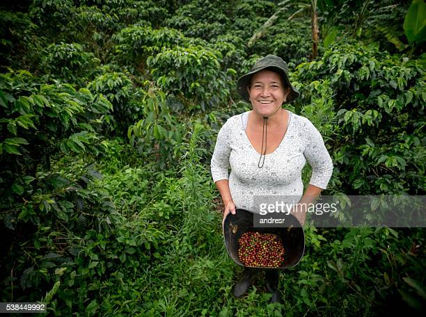 Woman collecting coffee beans at a farm