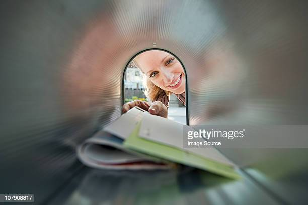 woman collecting mail from mailbox - mail stock pictures, royalty-free photos & images