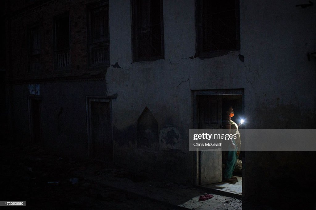 A woman collects belongs from her damaged home in Shankhu on May 3, 2015 in Kathmandu, Nepal. A major 7.9 earthquake hit Kathmandu mid-day on Saturday, and was followed by multiple aftershocks that triggered avalanches on Mt. Everest that buried mountain climbers in their base camps. Many houses, buildings and temples in the capital were destroyed during the earthquake, leaving over 6000 dead and many more trapped under the debris as emergency rescue workers attempt to clear debris and find survivors. Regular aftershocks have hampered recovery missions as locals, officials and aid workers attempt to recover bodies from the rubble.