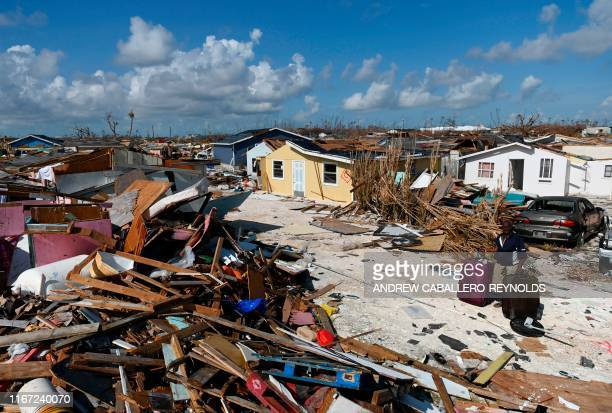 A woman collects his belongins before going to the port to evacuate in Marsh Harbour Bahamas on September 10 one week after Hurricane Dorian Bahamas...