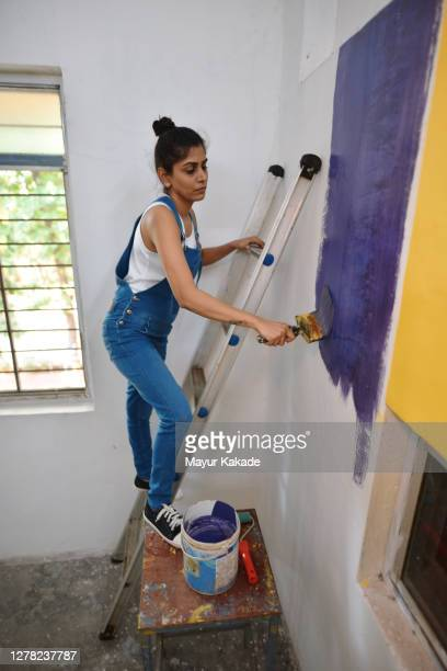 woman coloring interiors of her workshop - artist stock pictures, royalty-free photos & images