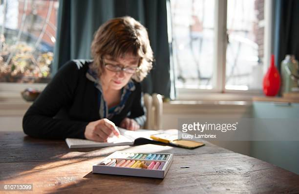Woman coloring with crayons