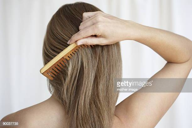 Woman combing hair