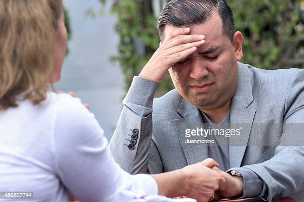 Woman comforting a depressed man