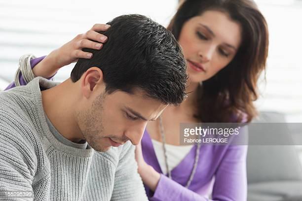 Woman comforting her husband