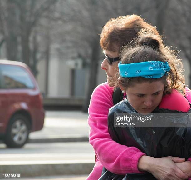 Woman comforts a crying young runner. © Bick 2013