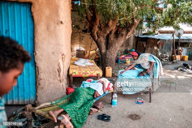 Woman comforts her young daughter as she recovers from her wounds as another woman also wounded recovers next to her, in Humera, Ethiopia, on...