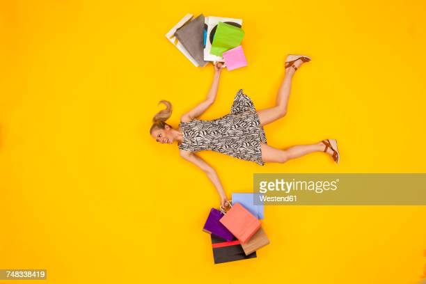 Woman coming from a shopping spree, carrying shopping bags