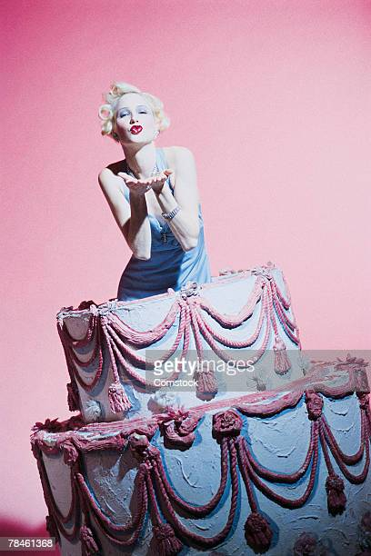 Woman coming out of cake