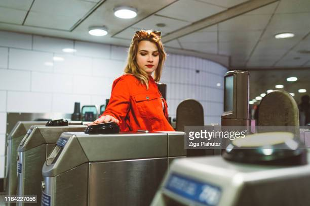 woman commuter entering london tube - london underground stock pictures, royalty-free photos & images