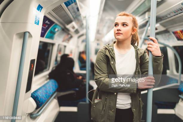 woman commuter on london underground train - london underground stock pictures, royalty-free photos & images