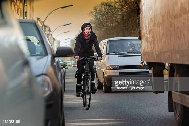 Woman Commuting by Bicycle