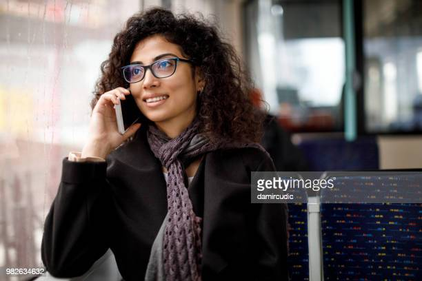 woman commuting by public transport - coach bus stock photos and pictures